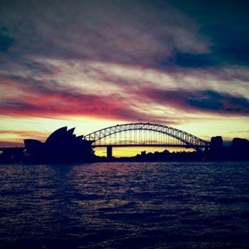 Zonsondergang met opera house en harbour bridge
